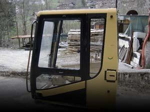 Cabinas y protecciónes FOPS/ROPS usadas.