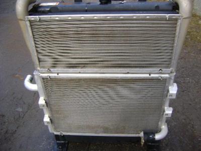 Radiador de aceite para Caterpillar 315C vendida por PRV Ricambi Srl